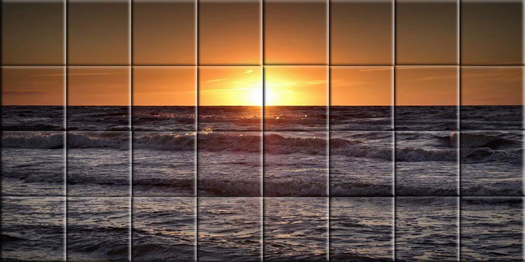 Mural en cerámica, amanecer en el mediterráneo donde se ve salir el sol por el horizonte del mar.